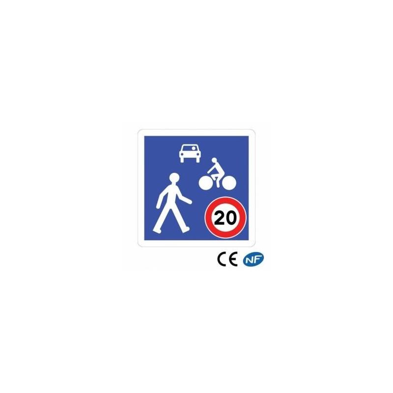 Panneau code de la route indiquant une zone de rencontre entre véhicules et piétons